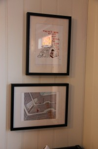 Two prints hung
