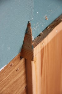 We'll have to figure out a way of sawing off the end of this moulding, it continues through the wall into the bedroom.