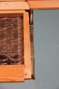 The top of the wall with the godawful glass inserts. And a hole through into the bedroom.